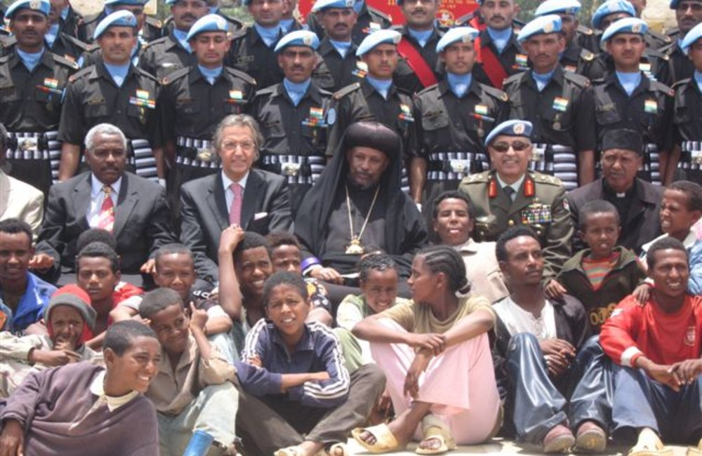 Ethiopian schoolchildren join peacekeepers and visiting dignitaries at  a medals parade for the  Indian Batallion in Adigrat on 4 August 2007 (UNMEE Photo: Ian Steele)