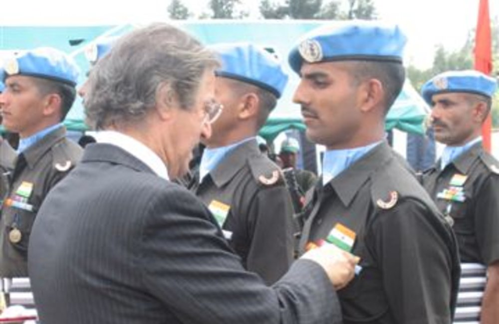 Azouz Ennifar, Acting Special Representative of the Secretary-General General pins a peace medal on a soldier of the Indian Batallion, Grenadiers in Adigrat, 4 August 2007 (UNMEE Photo: Ian Steele)