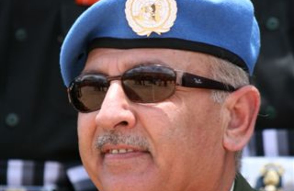 Force Commander Major General Mohammad Taisir Masadeh (Jordan) attends a medals ceremony for peackeepers of the Indian Batallion, Grenadiers in Adigrat, Ethiopia 4 August 2007  (Photo: Ian Steele)