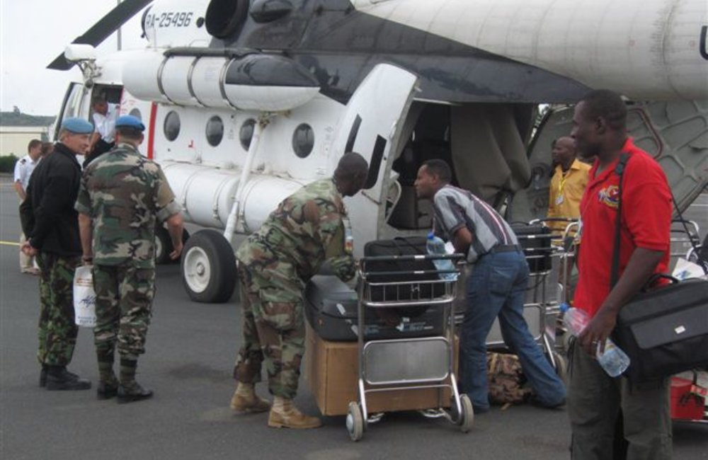 UNMEE military and civilian staff en route to Addis Ababa on 6 August 2008, following the Security Council's decision not to renew the Mission mandate. (Photos: Ian Steele)